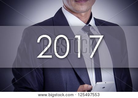 2017 - Young Businessman With Text - Business Concept