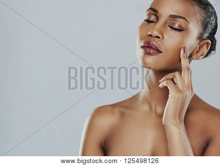 Calm Woman With Closed Eyes And Touching Cheek