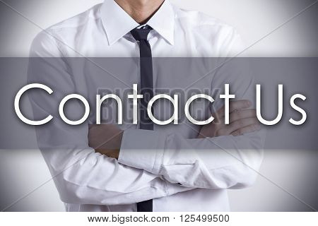 Contact Us - Young Businessman With Text - Business Concept