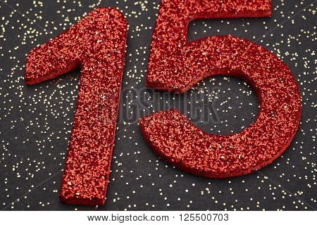 Number fifteen red color over a black background. Anniversary. Horizontal