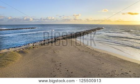 Aerial view of  The Spit seawall wave break and beach at sunrise. Gold Coast, Australia