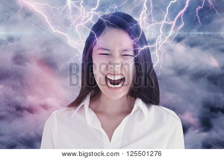 Screaming woman against cloudy sky