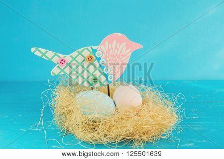 Easter eggs in a bird's nest on a blue background.