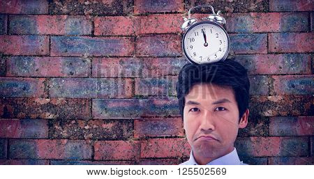 Businessman showing his empty wallet against brick wall
