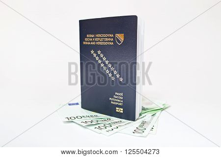 Bosnian passport and euro banknotes  on white background