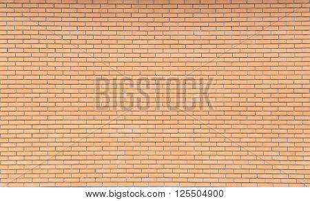 Orange brick wall. Close-up picture of bricks.