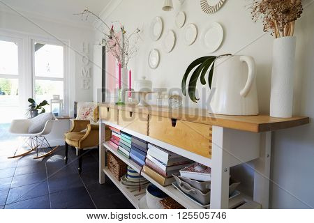 Sideboard In Dining Room Of Contemporary Family Home