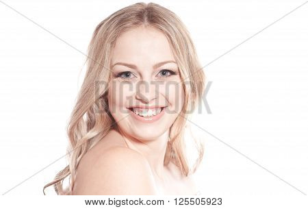 Laughing blonde girl 20-24 year old posing over white. Looking at camera. Happiness. Cheerful.