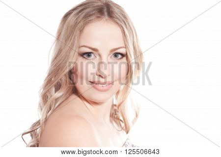 Smiling blonde girl 20-24 year old posing over white. Isolated. Young woman looking at camera.
