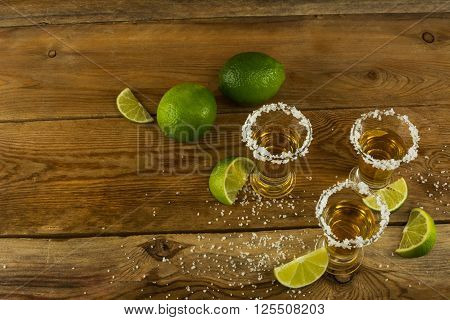 Gold Mexican tequila with lime and salt. Tequila. Tequila shot