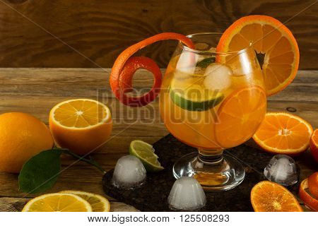 Pitcher of cool lemonade on wooden table. Summer drink. Fruit cocktail. Fruit drink. Fruit lemonade. Citrus lemonade
