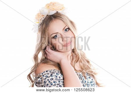 Smiling young woman wearing floral hairband over white. Looking at camera. Isolated. Elegance.