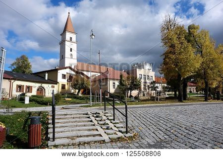 Vrbov, POPRAD, SLOVAKIA - OCTOBER 18, 2015: Autumn landscape with church and yellow trees in Vrbov town in Tatry mountains Slovakia.