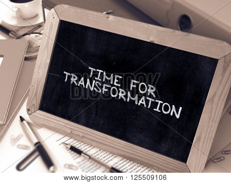 Time for Transformation Concept Hand Drawn on Chalkboard on Working Table Background. Blurred Background. Toned Image. 3D Render.