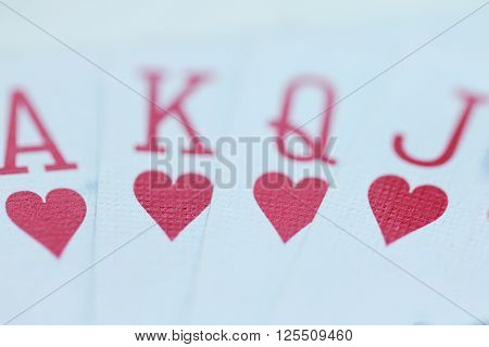Playing cards with hearts close up macro photo