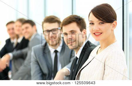 Business Team Having Informal Meeting In Office