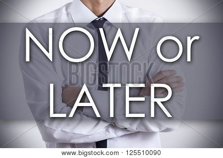 Now Or Later - Young Businessman With Text - Business Concept