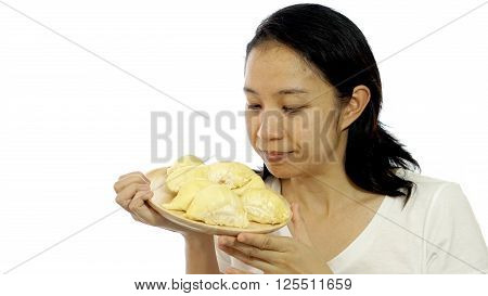 Asian girl smelling stinky durian. Smelly fruit in summer of tropical area