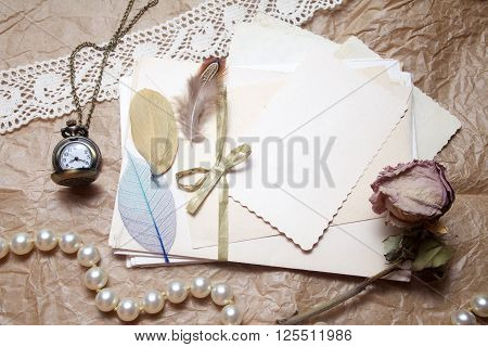 Old accessories and post cards. sentimental vintage background