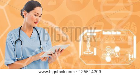 Surgeon using digital tablet with group around table in hospital against medical icons