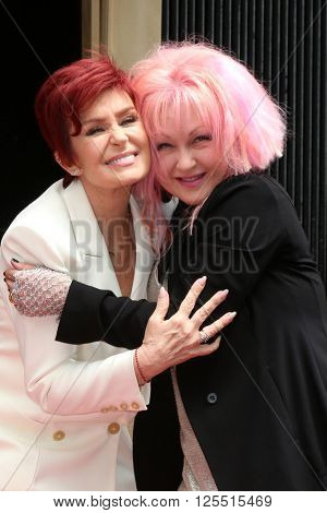 LOS ANGELES - APR 11:  Sharon Osbourne, Cyndi Lauper at the Harvey Fierstein and Cyndi Lauper Hollywood Walk of Fame Ceremony at the Pantages Theater on April 11, 2016 in Los Angeles, CA