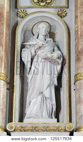 ZAGREB, CROATIA - SEPTEMBER 14: St. John the Evangelist statue on the main altar in Basilica of the Sacred Heart of Jesus in Zagreb, Croatia on September 14, 2015