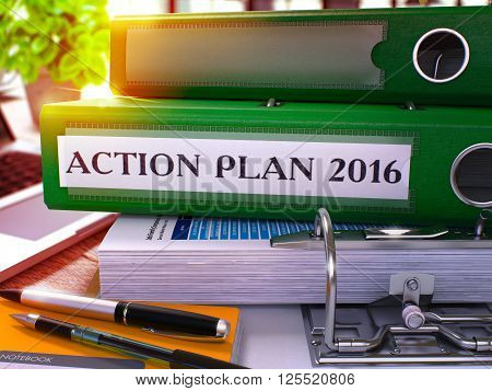 Green Ring Binder with Inscription Action Plan 2016 on Background of Working Table with Office Supplies and Laptop. Action Plan 2016 Business Concept on Blurred Background. 3D Render.