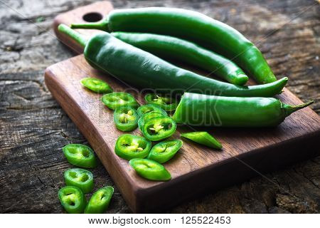 Fresh Green Chilli On Old Wooden Background
