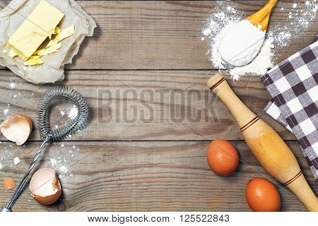 Eggs, Flour, Butter On The Wooden Table. Basic Baking Background