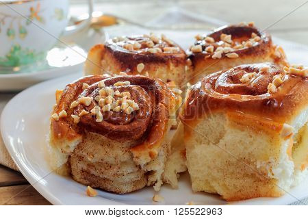 Sweet buns with cinnamon nuts and caramel syrup. Shallow DOF