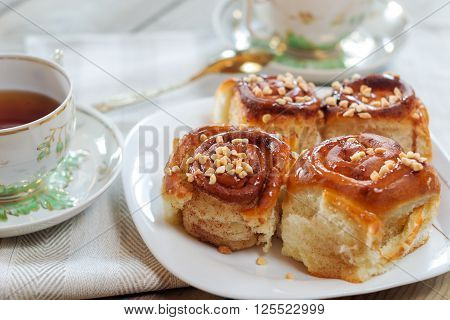 Sweet buns with cinnamon nuts and caramel syrup.