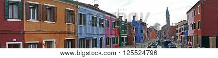 BURANO ITALY - JANUARY 25 2016: Panoramic view of Burano Italy an island with colorful architecture in the Venetian Lagoon.Tourists on the streets.