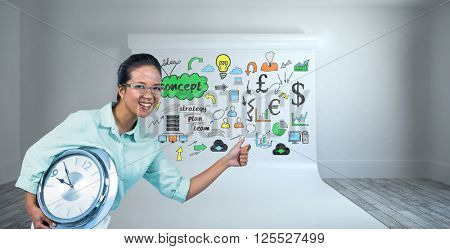 Delighted businesswoman holding a clock against large white screen