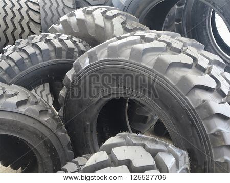 New black tractor abstract tire wheels background.