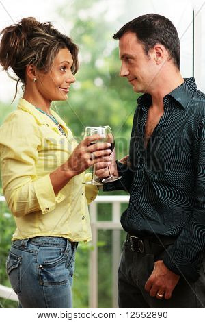 Beautiful Adult Couple With Glasses Of Wine