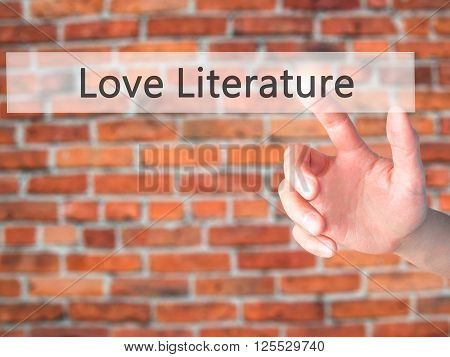 Love Literature - Hand Pressing A Button On Blurred Background Concept On Visual Screen.