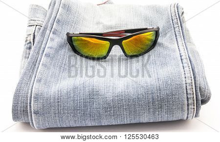 Image sun glasses on blue jeans background