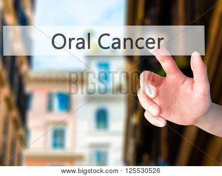 Oral Cancer - Hand Pressing A Button On Blurred Background Concept On Visual Screen.