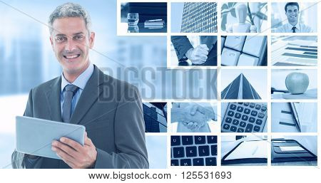 happy businessman using tablet pc against composite image of angry businessman thump the table