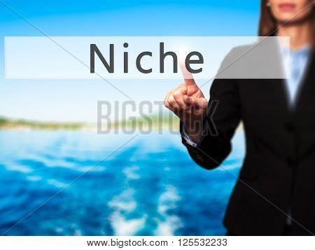 Niche - Businesswoman Hand Pressing Button On Touch Screen Interface.