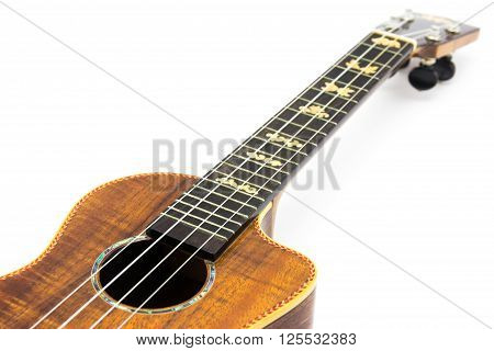 close up of ukulele on white background