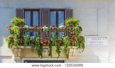 balcony with flowers in piazza navona rome