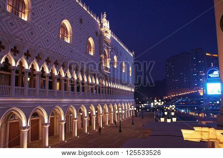 MACAU, MACAU S.A.R. - NOVEMBER 23: The night facade of Venetian casino resort Doge's Palace and luxury hotels in Macau Peninsula on 23th of November, 2015 in Macau.
