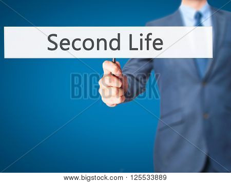 Second Life - Businessman Hand Holding Sign