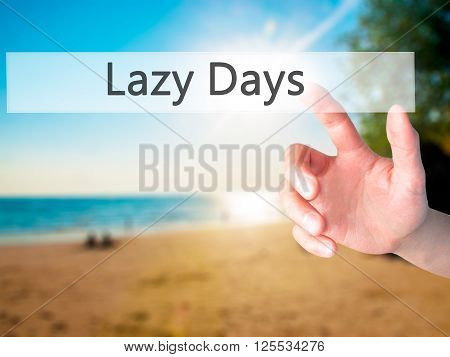 Lazy Days - Hand Pressing A Button On Blurred Background Concept On Visual Screen.