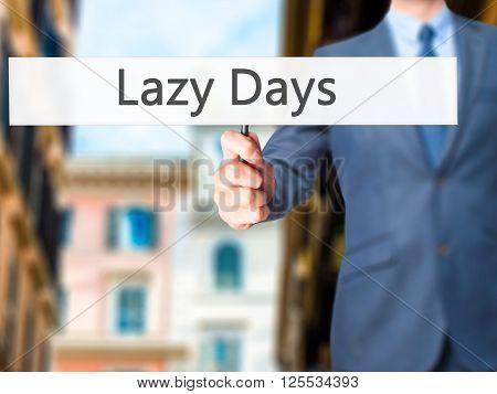Lazy Days - Businessman Hand Holding Sign