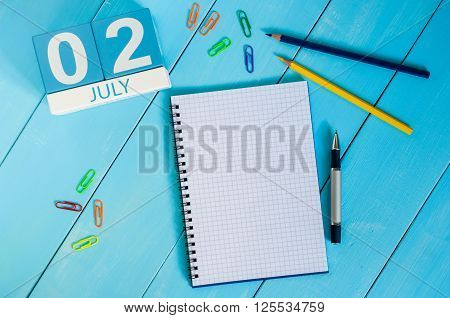 July 2nd. Image of july 2 wooden color calendar on blue background. Summer day. Empty space for text. World Sports Journalists Day. UFO DAY.