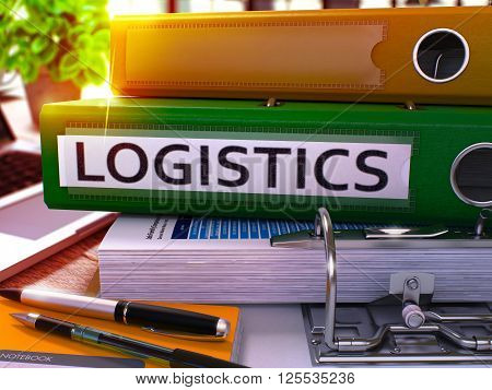 Green Office Folder with Inscription Logistics on Office Desktop with Office Supplies and Modern Laptop. Logistics Business Concept on Blurred Background. Logistics - Toned Image. 3D Rendering.