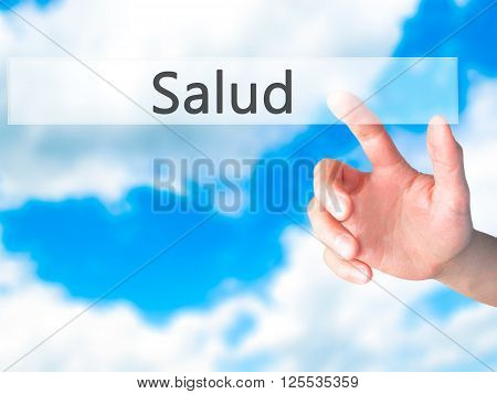 Salud - Hand Pressing A Button On Blurred Background Concept On Visual Screen.