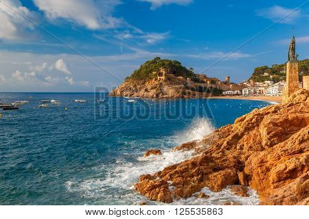 Statue of Minerva on the enbankment, Fortress and Badia de Tossa bay in Tossa de Mar on Costa Brava in the morning, Catalunya, Spain